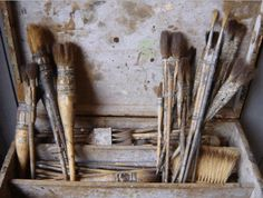 greige tones vignette of well-used paint brushes and tool box