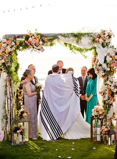Gorgeous chuppah covered in blush florals and greenery