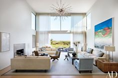 Architect Frederick Stelle, interior designer Thad Hayes and landscape architect Christopher LaGuardia collaborated on a family's beach house in Water Mill, New York. The living room. The oil at right is by Tadashi Sato. Club chair fabric, Glant. Sofa and daybed fabrics, Great Plains. Beauvais carpet | archdigest.com