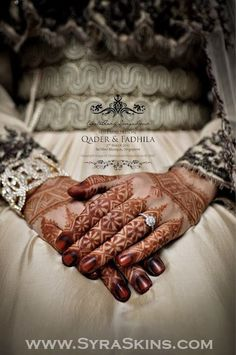 Moroccan bridal henna... This is a great bridal henna picture because the henna design is beautiful and Visible Plus her wedding ring stands out with nothing else distracting any attention from it :)