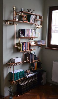 Copper pipe and pallet wood shelf — super easy to make.