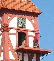 The Dietemann, symbol of Eschwege, blows his horn on the hour after emerging from the Eschweger Schloss Tower.