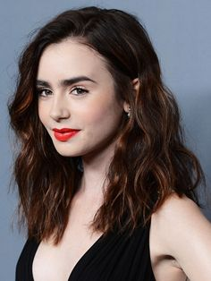 love the length and waves, naturally the brilliant orange lips