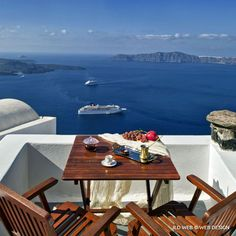 Coffee time, Volcano and boats. Greece, Santorini