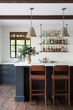When it comes to a home bar, channeling these elements into the design means rethinking the usual suspects — bar stools, backsplashes, and even the shelving. Ahead you'll find six fresh and clever industrial bar ideas that are currently inspiring us. #hunkerhome #bar #homebar #barideas #industrialbar Open Kitchen And Living Room, Navy Kitchen, Custom Shelving, Open Shelving, Island With Seating, Modern Bar Stools, Lounge Design, Shelf Design, Custom Cabinets