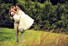 Beautiful picture of a groom holding his bride in our scenic fields!
