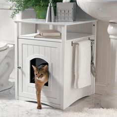 Kitty Washroom Furniture disguises the litter box. This cabinet combines good looks and practicality by hiding the litter box with style. FOR KITTY