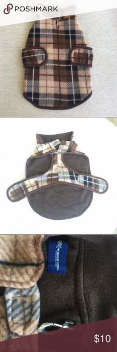 🐶 Brown Plaid Doggie Jacket 🐾 Brown and Tan Plaid Doggie Jacket. For medium size dogs; has opening for leash to clip through while Jacket is on; slips over dog's head with material covering their back and the opposing fabric then drawn along chest with each velcro piece attached for proper fit. This will not work for dogs with even slightly thicker necks since the neck is not adjustable. This item has been through the wash once after trying to find out if it fit my dog. Disappointed that…