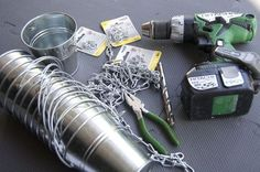 rain chain diy projects- use recycled cans or paint cans