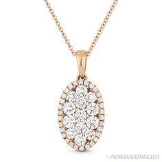 The featured pendant is cast in 18k rose gold and showcases an oval design adorned with round brilliant cut diamond clusters at the center and paved with round cut diamond accents set all the way around the oval outline.