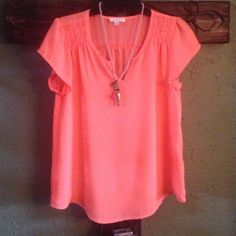 Gorgeous bright melon colored top V-neck short sleeve blouse/top.  100% polyester.  Worn one time.  No marks,stains.  Excellent condition Mine Tops Blouses