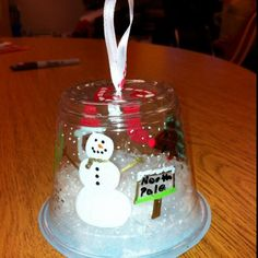 Snow globe ornaments - Materials needed - sharpies -plastic cups - ribbon - white stuffing - fake snow - round piece of paper | DIY Christmas Decorations Cheap