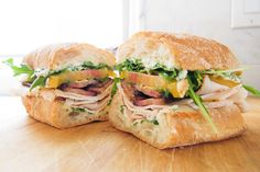 turkey and bacon sandwich with arugula + herb mayonnaise, quick pickled jalapeno and heirloom tomatoes.  YUM.