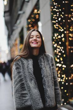 Christmas portrait of a girl. Illumination, lights. Photographer in Moscow