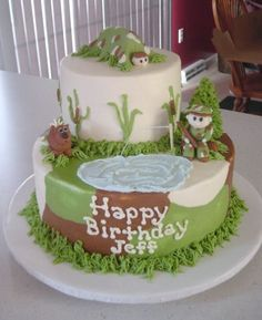 I had another request for a hunting and fishing cake.  The cakes are 6 and 10 and iced in buttercream.  The deer, hunter, tent and camper are all made from fondant.  The tree is a cone of fondant and then covered in butter cream using a leaf tip.