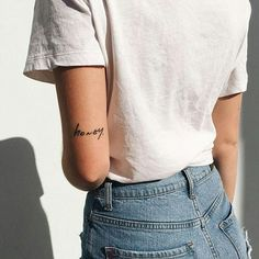 "this font but ""soul of a woman"" on left elbow and ""was created below"" on the right elbow"