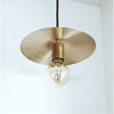 "A vintage 10"" cymbal that has seen life on the road, is now ready to quietly crank up the volume in your home. One of a kind pendant lamp made from a used cymbal and unfinished brass parts. Black lacquered top. Knurled nut accents for added ""ROCK"". 5ft Black cloth cord ready to be hard..."