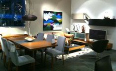 BoConcept Expanding dining table, Above the Sky art, and Volani wall system