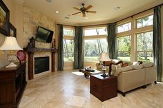 THE FAMILY ROOM OFFERS A FULL REAR WALL OF TALL WINDOWS WITH TRANSOMS FOR MAXIMUM LAKE VIEWS, 18