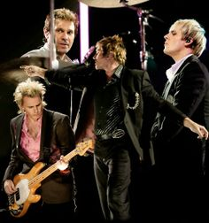 Duran Duran -- i graduated high school 1990. they were MY 80's BAND! won tickets just a few years ago. They still got it!!!!!!!!!! s~