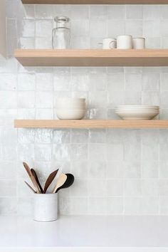 These walnut floating shelves are stunning! The ba. - These walnut floating shelves are stunning! The ba. - These walnut floating shelves are stunning! The ba. - These walnut floating shelves are stunning! The ba. Kitchen Remodel, Kitchen Design, Kitchen Shelves, Kitchen Wall, White Backsplash, Backsplash, Kitchen Marble, Kitchen Tiles Backsplash, Walnut Floating Shelves