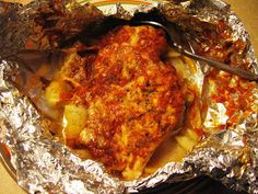 Difficulty: Easy 4 Boneless Skinless Chicken breasts 1 tsp Italian seasoning Salt & Pepper 4 medium potatoes, peeled, sliced very thin 1 cup marinara sauce 1/2 cup smoked mozzarella, grated 2 T...