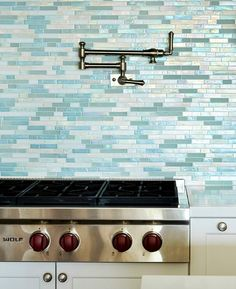 Sea glass tile kitchen backsplash tiles in shades of blue and turquoise, capturing the sparkling ocean waters: http://www.completely-coastal.com/2016/05/turquoise-blue-white-beach-theme-kitchen.html