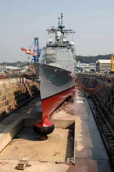 Yokosuka, Japan (Mar. 16, 2004) - The guided missile cruiser USS Cowpens (CG 63) at the completion of its Ships Repair Force (SRF) dry dock period in Yokosuka, Japan. The Ticonderoga class cruiser is forward deployed to Yokosuka. U.S. Navy photo by Photographers Mate 1st Class Alan Warner (RELEASED)