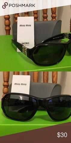 MIUMIU sunglasses MIUMIU black sunglasses. Brand new, never worn. Purchased at full price. Great deal Miu Miu Accessories Glasses