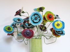 http://www.alittlemarket.com/autres-pieces-pour-creations/fr_coquelicot_hippie_design_ceramique_flower_power_kangooroobijoo_sur_tige_alu_vert_orange_-14274589.html