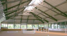 Indoor arena featuring garage door style walls for super ventilation