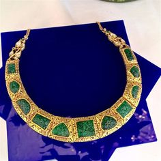 A carved emerald, diamond, and gold necklace.