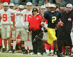 Read Plain Dealer accounts of every Ohio State-Michigan game since the big rivalry began. In Wolverines win over Buckeyes, Charles Woodson stakes his claim to Heisman Trophy with TD catch, punt return for TD. Michigan Wolverines Football, Ohio State Michigan, Michigan Athletics, Michigan Go Blue, Charles Woodson, Detroit Sports, Superbowl Champions, Wwe Roman Reigns, National Football League