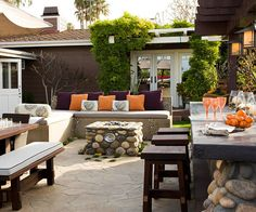 A stylish stone fireplace makes a stunning focal point for this cozy outdoor space. Get 15 tips for outdoor spaces: http://www.bhg.com/home-improvement/porch/outdoor-rooms/outdoor-room-ideas/?socsrc=bhgpin041913stonefireplace=3