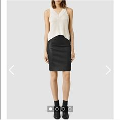 All Saints Black Pencil Skirt Reposh. Size 2. Zips up in the back. Feels like vegan leather-has a slight black metallic denim appearance. Comfortable and in good used condition. Slightly wrinkled since its been stored folded. Good staple piece. No trades and price is firm unless bundle meets auto discount. All Saints Skirts Pencil