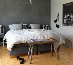 Double bed against grey wall, natural wooden floor and rustic bench in bedroom – 11315917 – Get high-quality interior design images for your projects – rights-managed and royalty-free Scandi Bedroom, Pastel, Home Living, Decoration, Design, Furniture, Home Decor, Lifestyle, Yurts