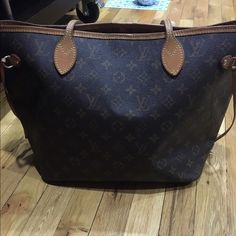 Well loved LV Neverfull MM Please understand this bag was well loved, and has some staining in interior and inside zipper pouch, along with a pen mark. The last number in date code is 4. Outside bag is in good shape. No trades. Louis Vuitton Bags Shoulder Bags