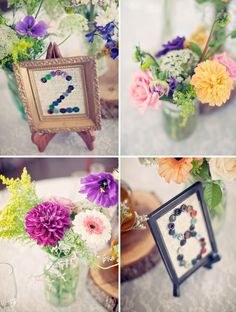 Love the buttons as table numbers & the flowers in mason jars