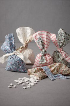 Soft pouches printed with vintage-inspired ditsy prints, plaid, and polka dots to fill with tasty treats for your family and friends.