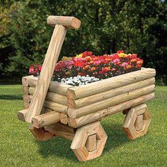 Cute wagon for a flower bed, made from landscape timbers.