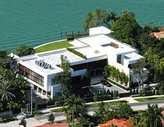 Alex Rodriguez's Home - If you are a baseball fan, you have likely heard of Alex Rodriguez. He is currently selling his home in Miami Beach, Florida for $38 million dollars, making it one of the pricier homes on the expensive celebrity homes list. This modern mansions features many modern luxuries that wouldn't expect to find in many mansions.