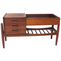 Arne Wahl Iversen Rosewood Credenza Planter Jardinieres | From a unique collection of antique and modern planters and jardinieres at https://www.1stdibs.com/furniture/building-garden/planters-jardinieres/