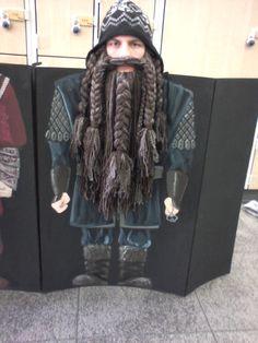 Alexander in his Hobbit Dwarf Beard, kneeling behind his costume Board #1 hand painted by his sister Rebecca.
