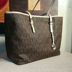 d4c45115683 Michael Kors Jet Set Brown print Medium Tote this bag is so beautiful,  brand new with the tags still on it. 14 inches at the base X 20 inches at  the top ...