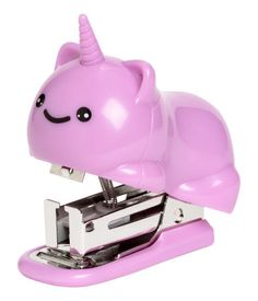 Purple/unicorn. Small plastic and metal stapler shaped like a cat with a unicorn horn. Size 2 1/4 x 2 3/4 in.