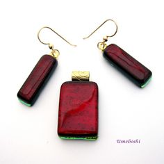 Handmade dichroic fused glass candy apple red jewelry set, pendant and dangle earrings by Umeboshi Jewelry designs. Deep handcrafted red glass jewelry.
