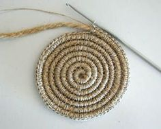 Crochet around rope or yarn to make rugs, baskets, trivets, etc. ..