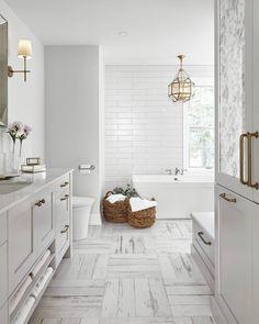 Farmhouse Bathroom via Home Bunch: Thecrosshatchfloor tiles contrast perfectly with thesubwaytilesin this farmhouse bathroom Design: @squarefootageinc by@valieriewilcox #bathroomdecor #bathroomdesign