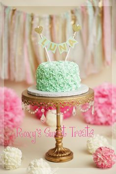 baby girl cake smash in vintage creams, mint, gold and pink colors