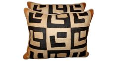 Pair of pillows made with authentic raffia African Kuba cloth.  Linen backs and self-cording. Sewn shut.
